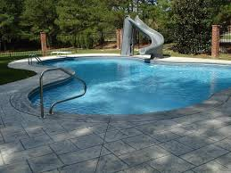 Swimming Pool:Captivating Small Pool Ideas With Artificial Waterfall And  Brick Wall Also Pool Chair