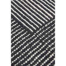 stripe rug round  whiteblack  tom dixon  horne