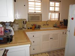 awesome art deco kitchen design ideas with living space simple white l shaped cabinetry granite top art deco inspired kitchen