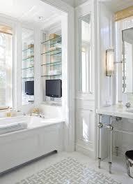 tub under built in shelves cottage bathroom