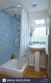 Bathroom With Tiles Blue Mosaic Wall Tiles Above Bath With White Shower Curtain In
