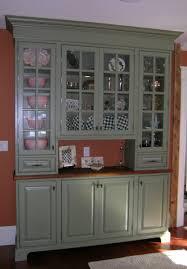 interior clear glass door. Exellent Interior Pale Grey Wooden Pantry Cabinet With 4 Clear Glass Doors And Two Drawers On  Dark Floor Plus Orange Wall In Interior Door