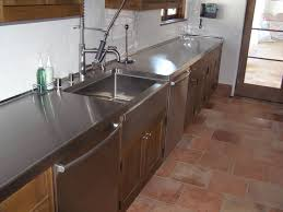 brushed stainless steel countertop with turn down at farmstyle sink