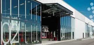 bi fold garage doorsDesigner Canopytype Bifold Garage Doors