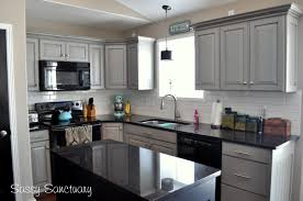 white cabinets black counters kutsko kitchen