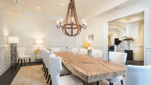 rustic dining room lighting fixture with rustic chandelier over rectangular natural wooden dining table and