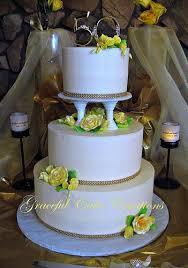 Elegant Ivory 50th Anniversary Cake with Yellow Gum Paste Roses |  Aniversarios, Pasteles