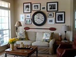 great picture arrangement - oar and clock - mix pictures with other wall  decor