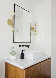 black white walnut bathroom with black faucet brass sconces brittanymakesdilemma with my bathroom lights the vintage rug the vintage