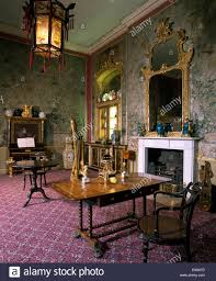 Antique furniture and lantern in old fashioned stately home