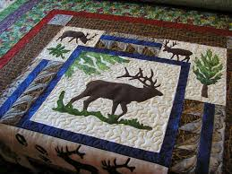 Creative Quilting by Debbie Stanton: The Lure of Woodland Quilts & This next quilt is the 2014 raffle quilt from my guild. It didn't take us  long to realize that woodland style quilts do better here than any other  style. Adamdwight.com