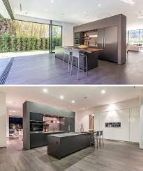 new home lighting. A Partial Wall Separates The Kitchen From Dining And Living Area. It Also Has An Island With Cantilevered Wooden Counter, Making Room For Bar Stools. New Home Lighting