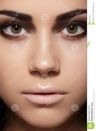 close up of model face with eye makeup clean skin