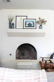 mid century modern living room with white fireplace