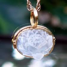 tiny 3 d moonstone lotus pendant in 18 karat gold by pedro