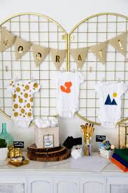 set up a diy baby shower onesie station
