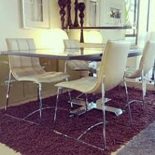 modern retro style dining chairs with a contemporary dining table