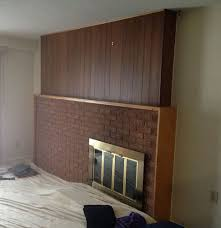 the house was built in the 60 s with paneling and brick for a fireplace surround