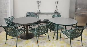group of outdoor furniture including eight chairs glass top table ht 26 1 2 in dia 47 in glass serving table three small iron urns one as is