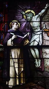 thomas aquinas icon of the crucifixion speaking to thomas aquinas is depicted on this stained glass window in saint patrick church columbus ohio