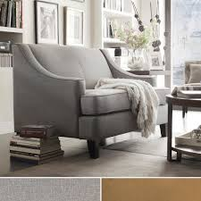 Winslow loveseat features sloping arms, T-shaped seat cushion and tapered,  cherry or espresso-stained feet are the hallmarks of this Collection.