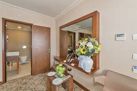 deluxe double or twin room guestroom showing item 45 of 96 suite 1 double or 2 single beds living bekdas hotel deluxe istanbul interior entrance