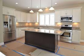 light brown kitchen cabinets with granite countertops white and colored dark full size wood grey black