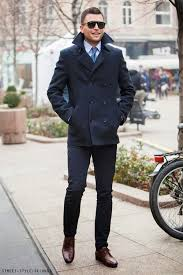 try teaming a deep blue pea coat with deep blue dress pants like a true gent