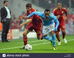 Munich's Thomas Müller (L) and Juan Zuniga of Naples fight for the Stock  Photo - Alamy