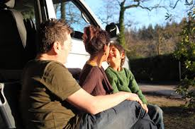 2018 volkswagen camper van. simple volkswagen family relaxing together while stting outside vw campervan  with 2018 volkswagen camper van