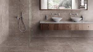 photo features kenilworth 13 x 13 and 2 x 2 mosaics in gray on walls and