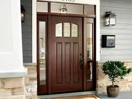 entry doors in a dark wood finish