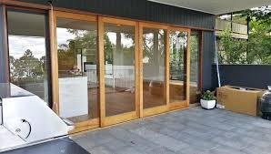 exotic external sliding doors centre opening timber sliding doors stacking externally over wall with glass louvre