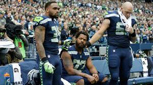 Are NFL players required to stand for the national anthem? | KIRO-TV