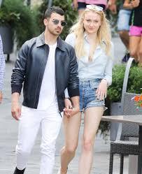 Joe jonas with a girl