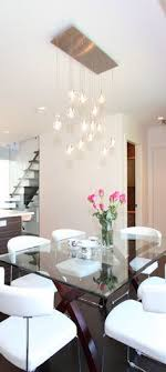 lighting dining table. dining room light fixture is nice glass table but metal legs and do not like the chairs lighting