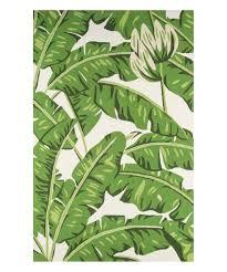 love this dark green palm leaves indoor outdoor veranda rug