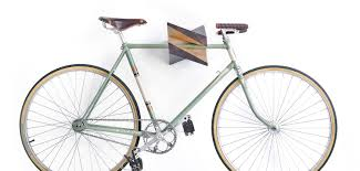 The wooden Iceberg Chestnut is an X-shaped bike storage rack that doubles  as fine