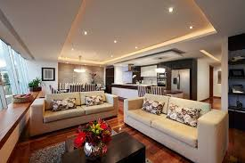 modern living room with high ceilings and cove lighting