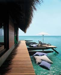 5 stars resort in maldives reethi rah grand water villa exterior design surrounded by chic decking wraparound over water hammocks cushions and platforms for