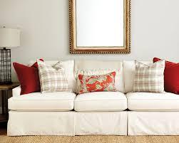 y orange throw pillows on a sofa