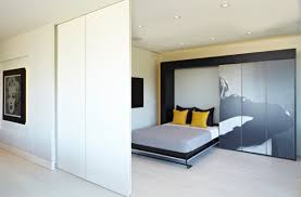 ... Morphs into a sleek and stylish bedroom thanks to the Murphy bed!