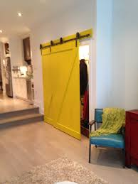 Bypass Barn Door An Eclectic Home Makes A Bold Move With Two Yellow Barn Doors