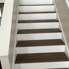 luxury vinyl plank on stairs with white risers luxury carpet tiles for concrete stairs
