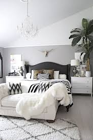 black n white furniture. Neutral Bedroom With Crystal Chandelier, Button Tufted Chaise, Black And White Accents Leather Studded Wingback Bed - Cuckoo4Design N Furniture