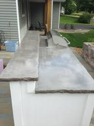 outdoor kitchen with upper lower concrete countertops natural grey concrete with broken rock edge option