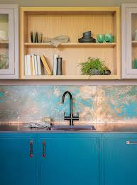 its hampton court kitchen combines shaker style drawers and cabinets in dusty pinks and turquoise offset with dazzling copper hand aged splashbacks