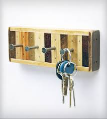 4-Hook Reclaimed Wood Key Holder   This four-hook key holder or jewelry