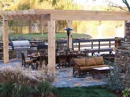 Making An Outdoor Kitchen Fancy Lake View With Great Wood Roof Above Large Brown Dining