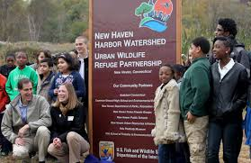 URI and USFWS announcement USFWS U.S. Fish & Wildlife Service Director Dan  Ashe and Northeast Regional Director Wendi Weber unveil the designation  sign with students from Common Ground High School and Barnard Environmental  Studies Magnet ...